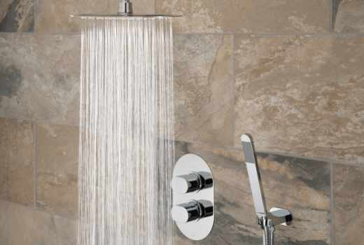 Showers at GeoJones Bristol Bathroom Showroom - Vado concealed thermostatic shower valve with slim rainfall shower head and hand shower